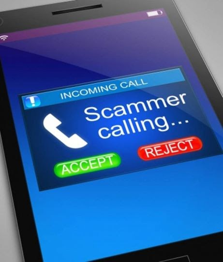 "Phone screen that has a blue square that says ""Scammer calling""."